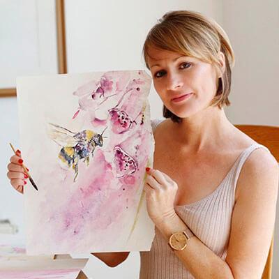 Jennifer holding bee design